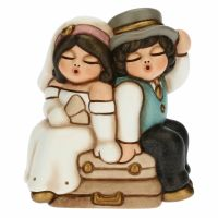Ironic newlywed couple on suitcases