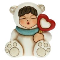 Baby polar bear with lollipop