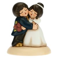 Classic newlyweds with bouquet cake topper