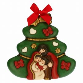 Christmas tree with Holy Family decorative plaque
