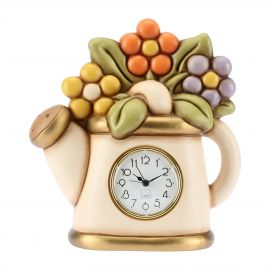 Table clock with watering can and flowers