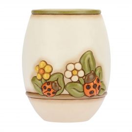 Country vase with flowers and lucky ladybird