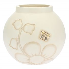 Elegance vase with flowers and butterfly