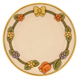 Country ceramic centrepiece with flowers and bow