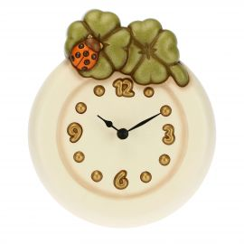 Wall clock with four-leaf clovers and lucky ladybird