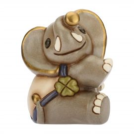 Playful elephant with lucky four-leaf clover