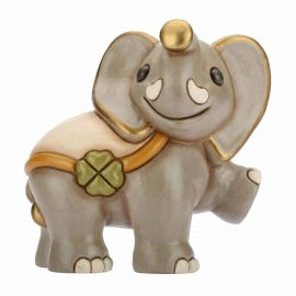 Walking elephant with lucky four-leaf clover