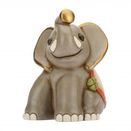 Cheerful elephant with lucky four-leaf clover