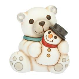 Small polar bear and snowman