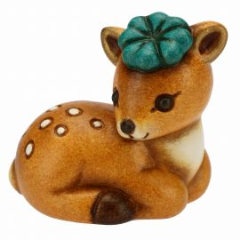 Fawn with lucky four-leaf clover