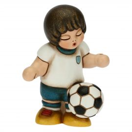Boy footballer playing with ball