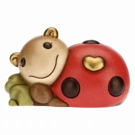 Joyful Ella ladybird with lucky four-leaf clover