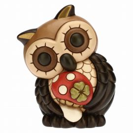Large owl with mushroom