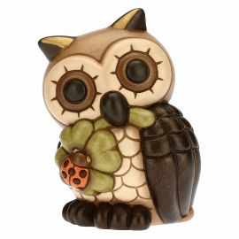 Wise owl with lucky four-leaf clover