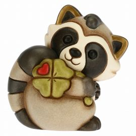 Happy Pepito the Raccoon with lucky four-leaf clover