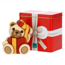 Playful Teddy in parcel and tin box