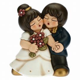 Brautpaar Hand in Hand mit Bouquet
