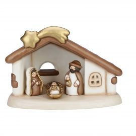 Stable set with shooting star and Holy Family with Jesus, Joseph and Mary