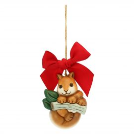 Small Christmas decoration squirrel on branch