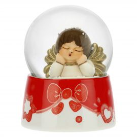 Glass snow globe with angel