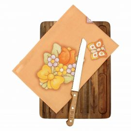 Country bread board with knife and tea towel